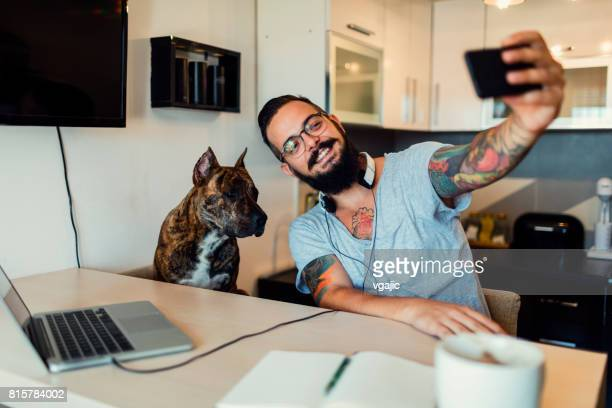 Man making selfie with his dog