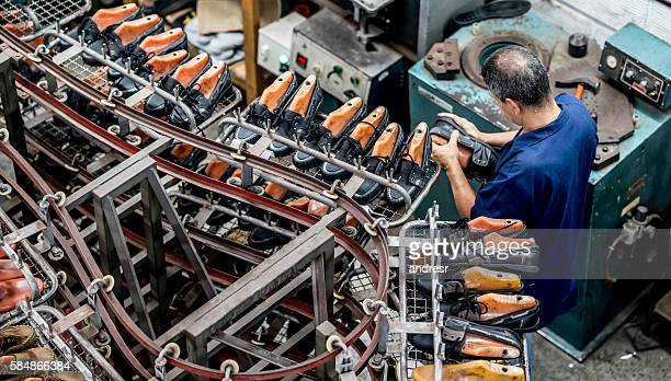 Man making shoes at a factory