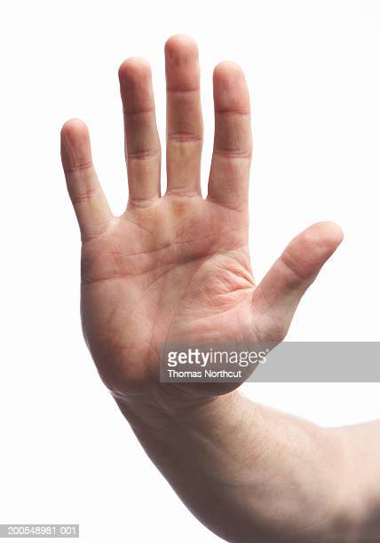 Man making stop gesture, close-up of hand