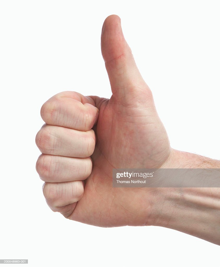 Man making thumbs up sign, close-up of hand : Stock Photo