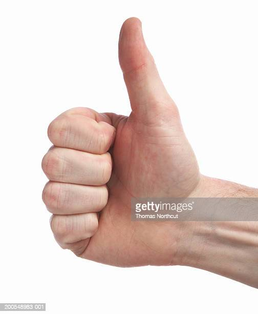 Man making thumbs up sign, close-up of hand