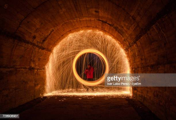 Man Making Wire Wool In Tunnel At Night