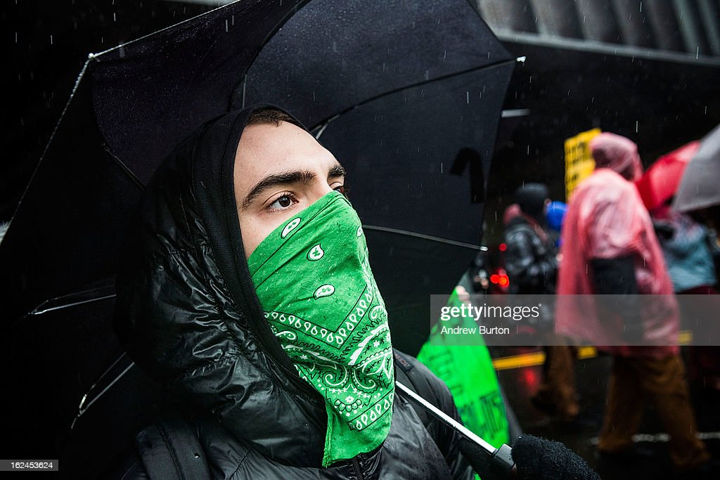 A man marches against police stop-and-frisk tactics on February 23, 2013 in New York City. The march, which consisted of a few hundred people, started in the Bronx borough of New York and marched into the Harlem neighborhood of Manhattan.