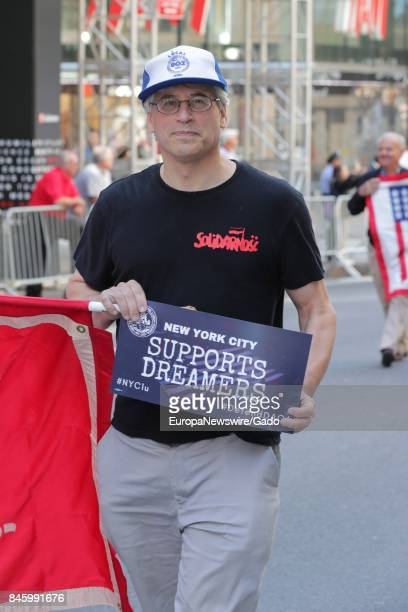 A man marches and holds a sign in support of Deferred Action of Childhood Arrivals during the 2017 Labor Day Parade on Fifth Avenue in New York City...