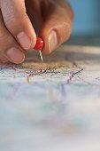 Man marking location on map