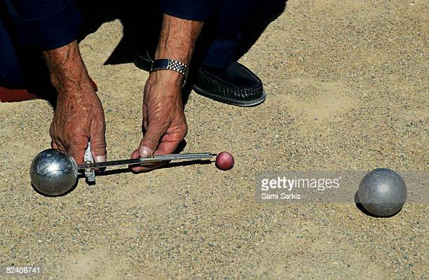 Man measuring distance between two boules balls