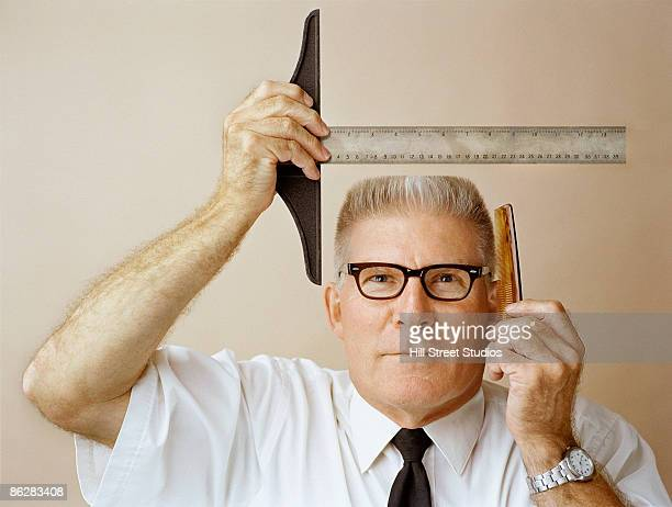 Man measuring his flat top for precision