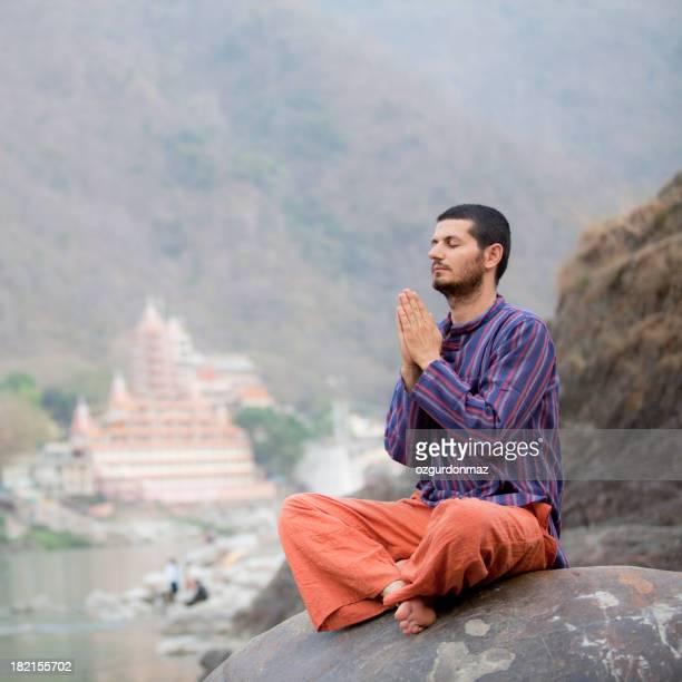 Man meditating in India