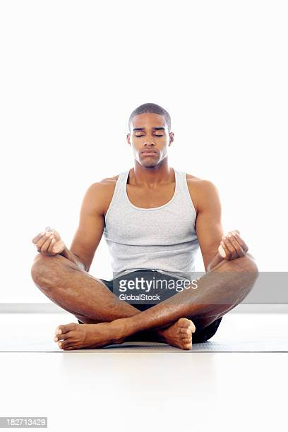 A man meditating in lotus position