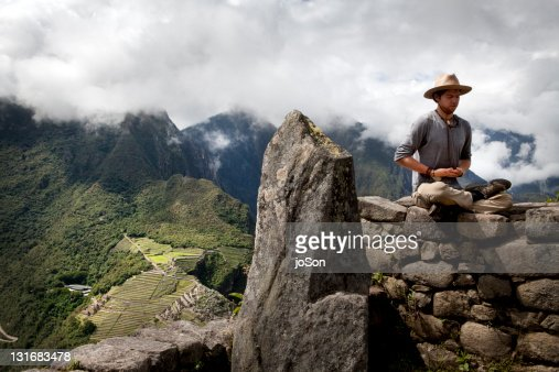 Man meditation, Machu Picchu ruins in background : Stock Photo