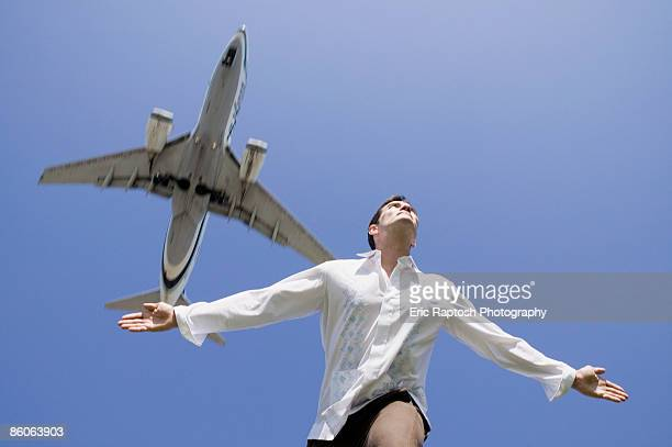 Man mimicking airplane