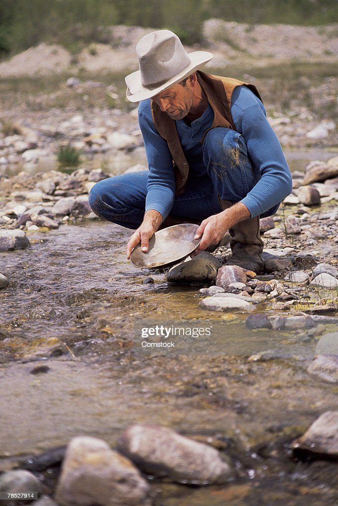Man mining for gold in South Platte River , Fairplay , Colorado