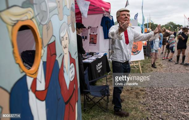 A man mocks President Donald Trump in the Healing Fields at Glastonbury Festival Site on June 24 2017 in Glastonbury England Labour Party leader...