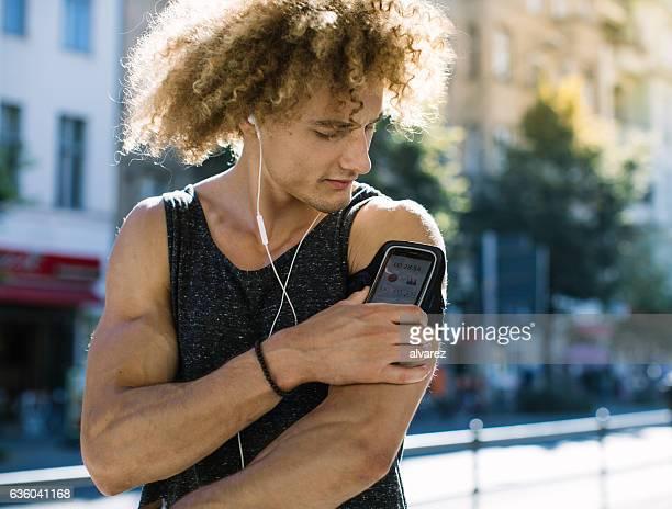 Man monitoring his health progress on mobile app