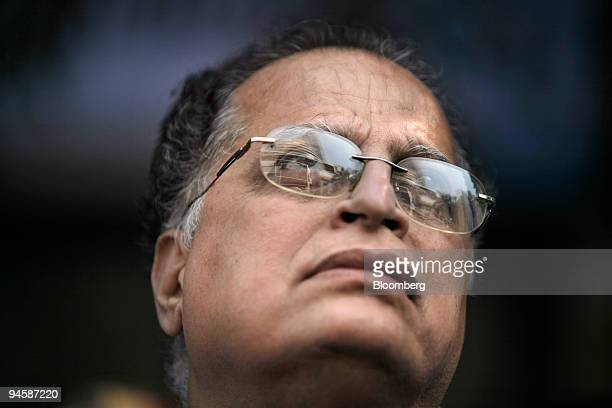 A man monitors market news outside the Bombay Stock Exchange building in Mumbai India on Tuesday Jan 22 2008 India's Finance Minister P Chidambaram...