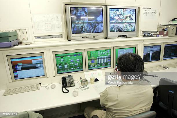 A man monitors screen at the central control room of Tokyo's earthquake proof Common utility duct which is being constructed by the Ministry of Land...