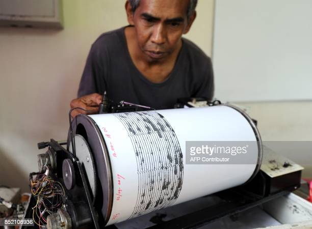 A man monitors seismic waves at the Mount Agung monitoring station in Karangasem on the Indonesian resort island of Bali on September 23 2017...