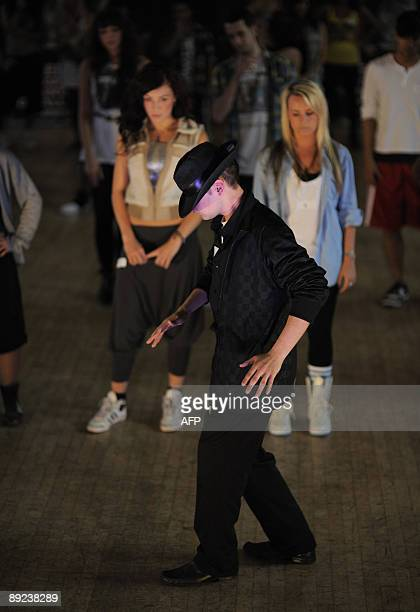 A man 'moonwalks' during the open auditions for the world tour of the West End dance show 'Thriller Live' in central London on July 24 2009 Auditions...