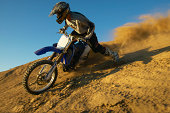 Man motocross riding in desert terrain