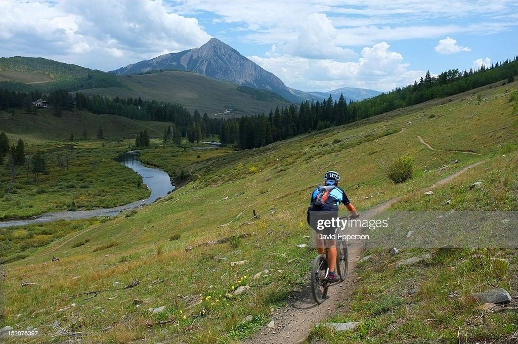 Man mountain biking on trail in Crested Butte : Stock Photo
