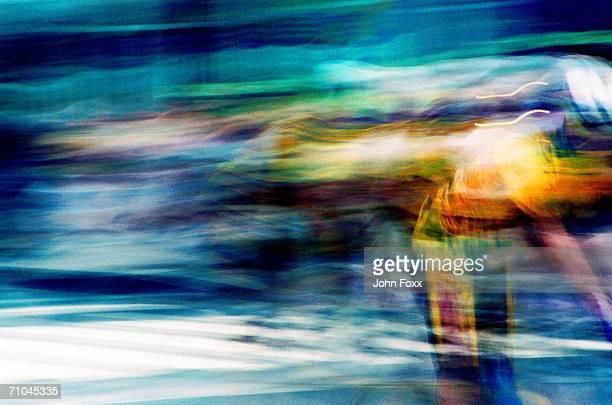 Man mountain biking (blurred motion)