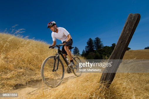 Man mountain biking, Saratoga, California.