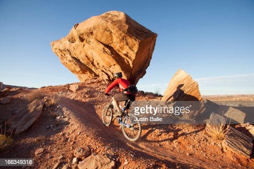Man mountain biking the 'North 40' trail near the Bar M area. Moab, Utah.