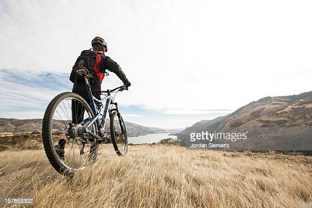 A man mountian biking.