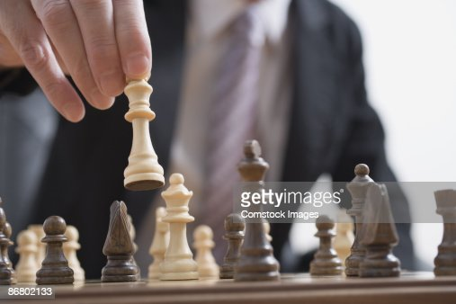 Man moving chess pieces