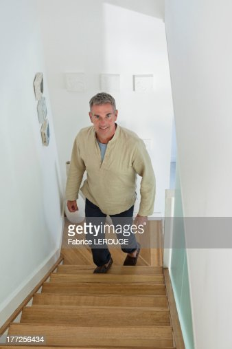 Man moving up on a staircase : Stock Photo