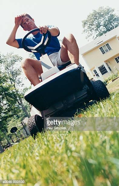 Man Mowing Garden