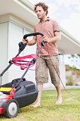 Man mowing green lawn