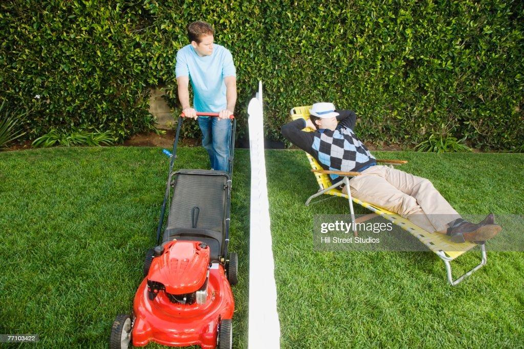 Man mowing lawn while neighbor sleeps