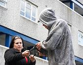 Man Mugging Woman In Street
