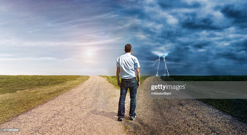 Man must decide his way forward to success or failure : Stock Photo