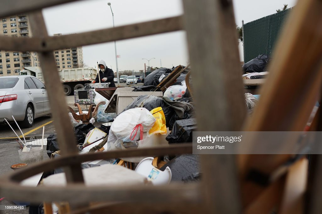 A man named 'Johnny' looks through discarded items from flood damaged homes after Hurricane Sandy in the Rockaways on January 15, 2013 in the queens borough of New York City. A $50.7 billion Superstorm Sandy aid package is expected to be voted on today in the House. The package, which has come under criticism by some fiscal conservatives, is being heavily pushed by Northeastern lawmakers. The money would be spent on immediate needs to the region including $5.4 billion for New York and New Jersey transit systems and $5.4 billion for the Federal Emergency Management Agency's disaster relief aid fund.