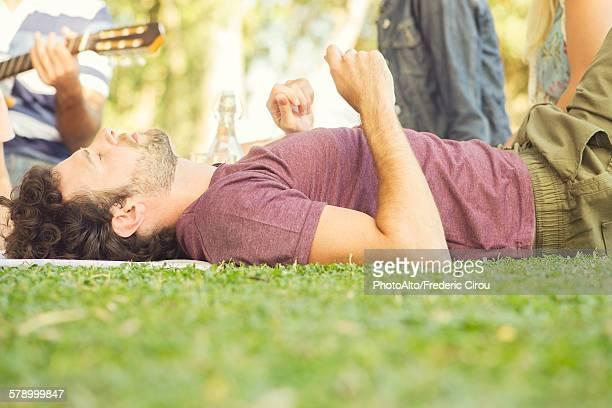 Man napping at picnic