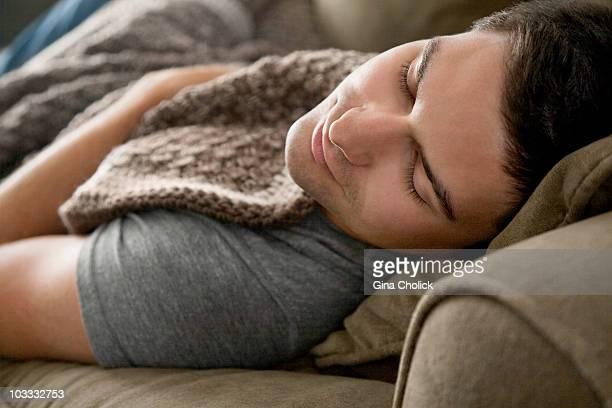 Man napping on sofa