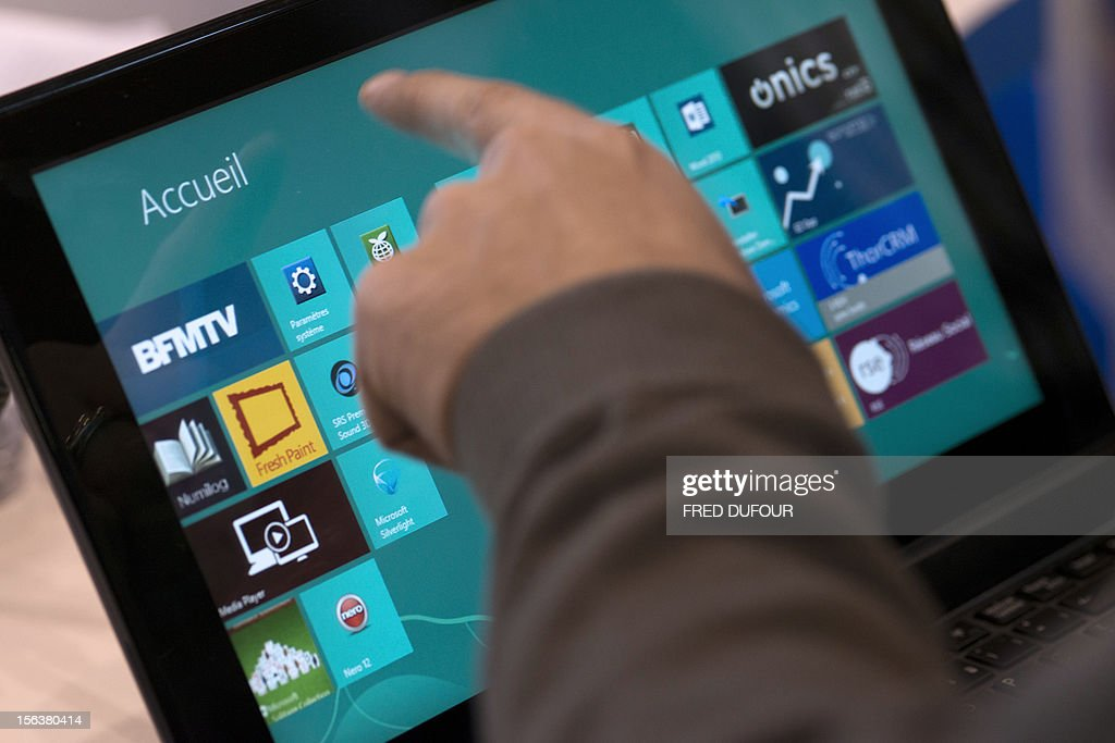 A man navigates with Windows 8 on a Tablet on November 14, 2012 in Paris.