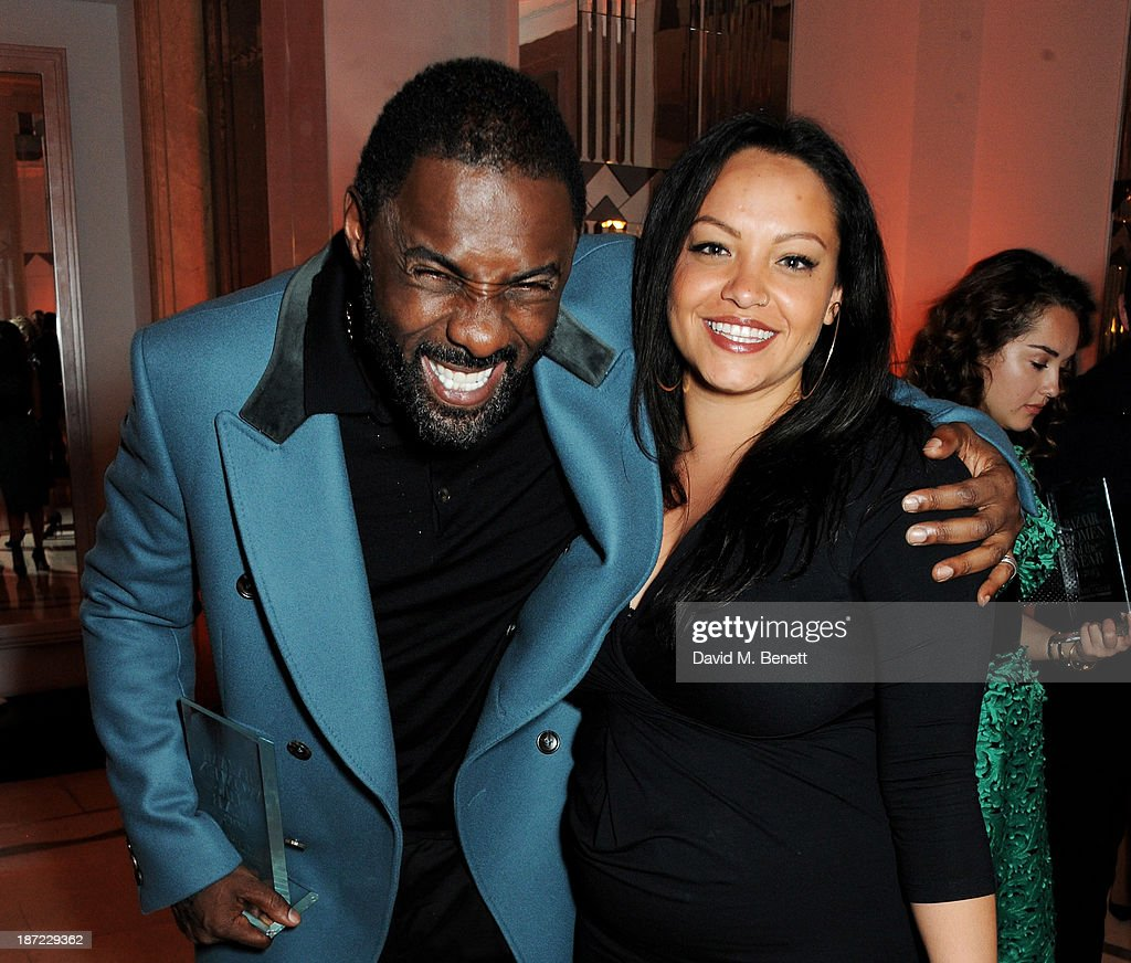 Man of othe Year <a gi-track='captionPersonalityLinkClicked' href=/galleries/search?phrase=Idris+Elba&family=editorial&specificpeople=215443 ng-click='$event.stopPropagation()'>Idris Elba</a> (L) and Naiyana Garth attend the Harper's Bazaar Women of the Year awards at Claridge's Hotel on November 5, 2013 in London, England.