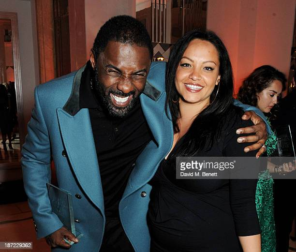 Man of othe Year Idris Elba and Naiyana Garth attend the Harper's Bazaar Women of the Year awards at Claridge's Hotel on November 5 2013 in London...