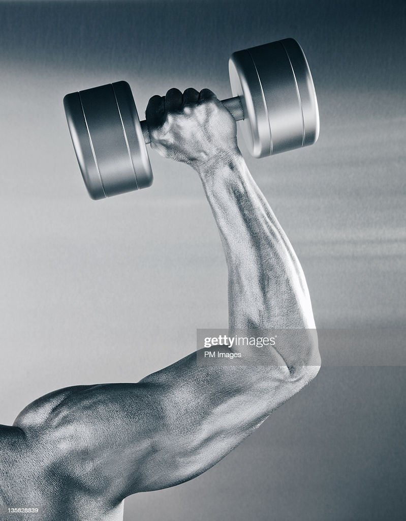 Man of steel working out : Stock Photo