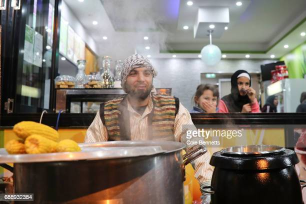 A man of Syrian decent mans a corn store while children look on in the southwestern suburb of Lakemba on May 27 2017 in Sydney Australia Muslims...