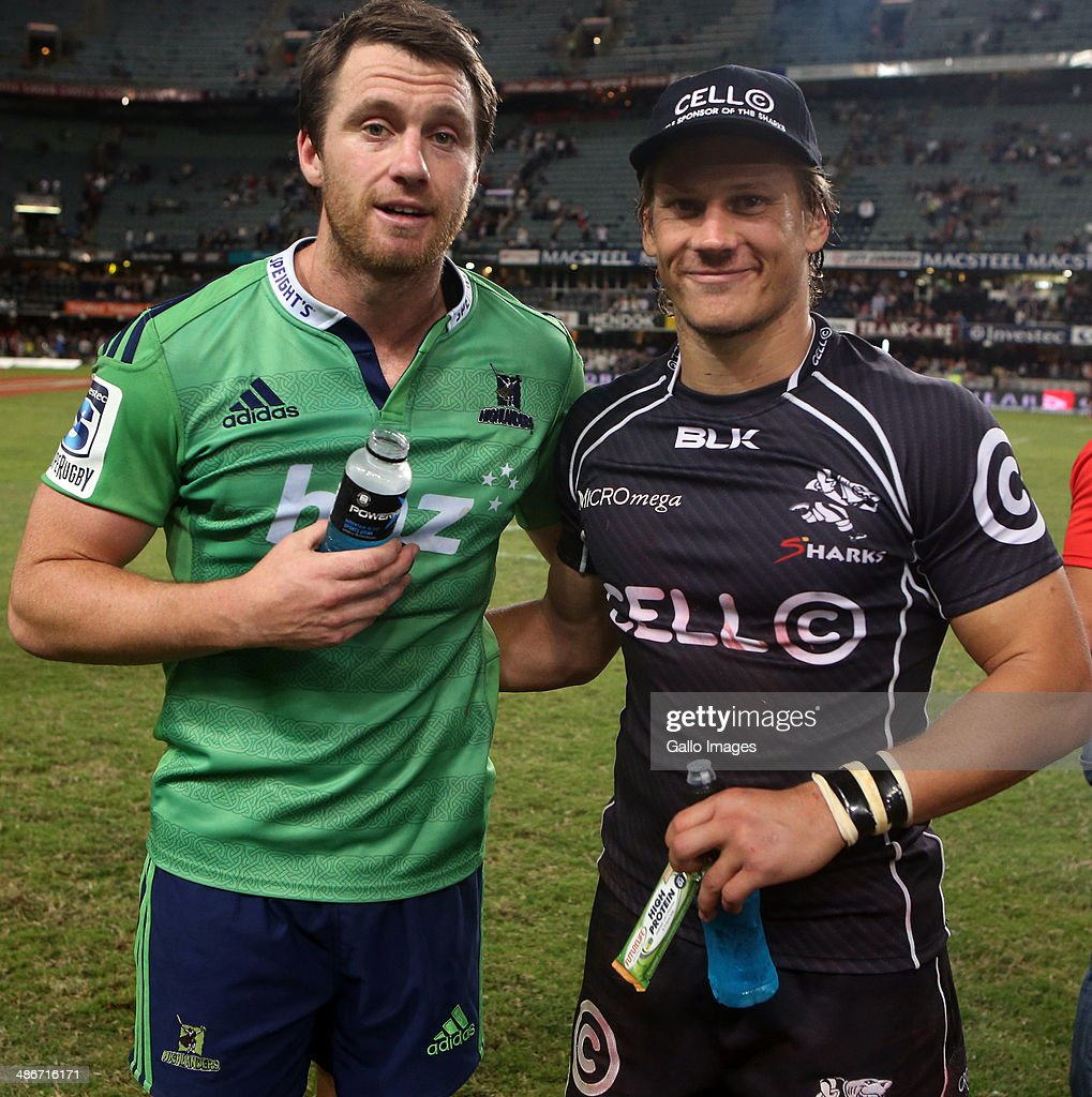 Man of the match Ben Smith (co-captain) of the Highlanders with Charl McLeod of the Cell C Sharks during the Super Rugby match between Cell C Sharks and Highlanders at Growthpoint Kings Park on April 25, 2014 in Durban, South Africa.