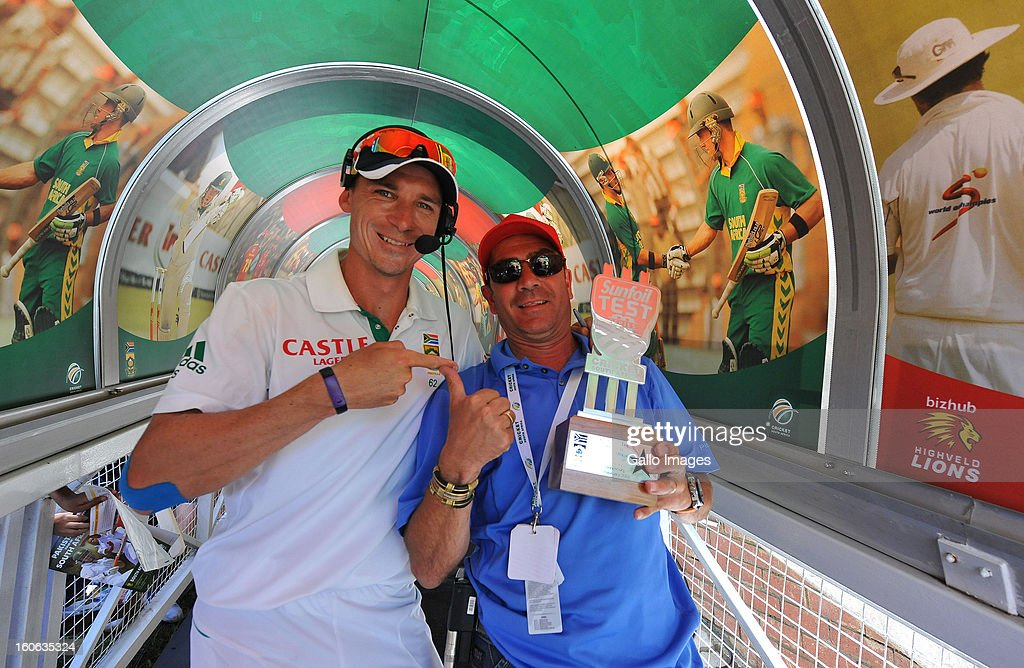 Man of the Match <a gi-track='captionPersonalityLinkClicked' href=/galleries/search?phrase=Dale+Steyn&family=editorial&specificpeople=649553 ng-click='$event.stopPropagation()'>Dale Steyn</a> of South Africa with floor manager Rui Marquis during day 4 of the 1st Test match between South Africa and Pakistan at Bidvest Wanderers Stadium on February 4, 2013 in Johannesburg, South Africa.