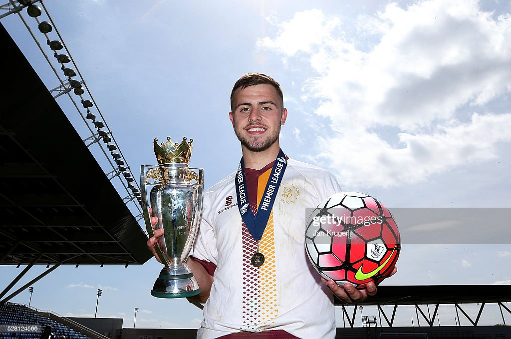 Man of the match Dominic Moan poses with the trophy and match ball after scoring a hat trick during the under 16 Schools' Cup final match between Thomas Telford School and Samuel Whitbread Academy at the Academy Training Ground on May 04, 2016 in Manchester, England.