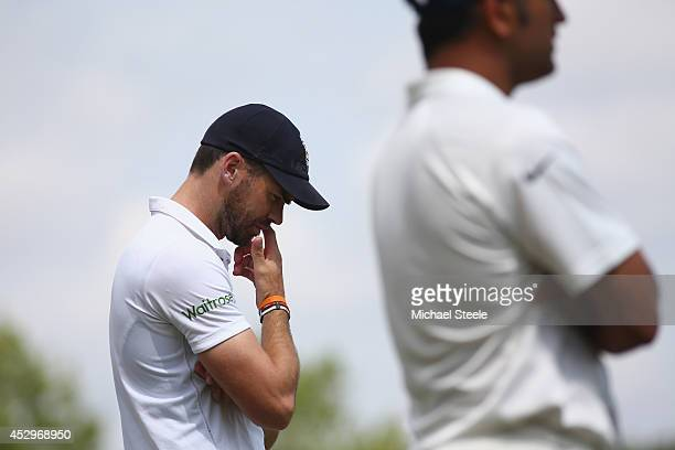Man of the match James Anderson of England with match bowling figures of 7 for 77 waits alongside MS Dhoni the captain of India at the end of match...