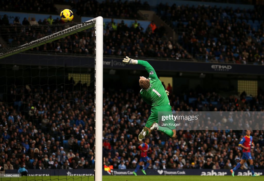 Man of the Match <a gi-track='captionPersonalityLinkClicked' href=/galleries/search?phrase=Joe+Hart&family=editorial&specificpeople=1295472 ng-click='$event.stopPropagation()'>Joe Hart</a>, Goalkeeper of Manchester City tips a shot at goal over the cross bar during the Barclays Premier League match between Manchester City and Crystal Palace at the Etihad Stadium on December 28, 2013 in Manchester, England.
