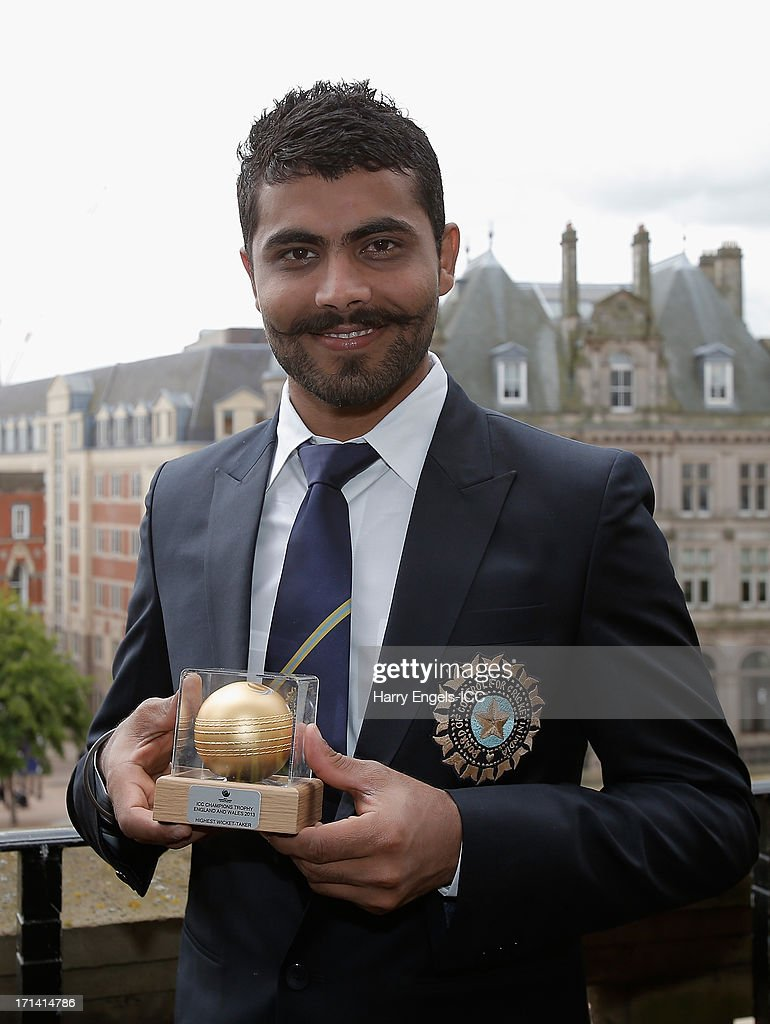 'Man of the Match' <a gi-track='captionPersonalityLinkClicked' href=/galleries/search?phrase=Ravindra+Jadeja&family=editorial&specificpeople=4880243 ng-click='$event.stopPropagation()'>Ravindra Jadeja</a> poses with his trophy during a photocall for the winners of the ICC Champions Trophy on June 24, 2013 in Birmingham, England.