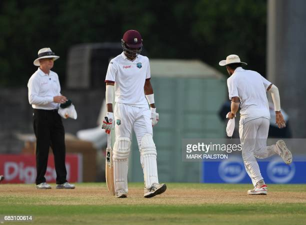 Man of the match Roston Chase of the West Indies leaves the field after being unbeaten on 101 during the final test match won by Pakistan who also...